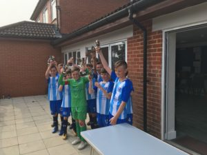 Milford on Sea celebrate winning the U11s Derrick Porter Cup by defeating Moordown and Southbourne