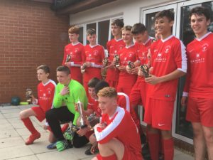 Bournemouth Poppies U15s celebrate winning the Alan Paull Trophy